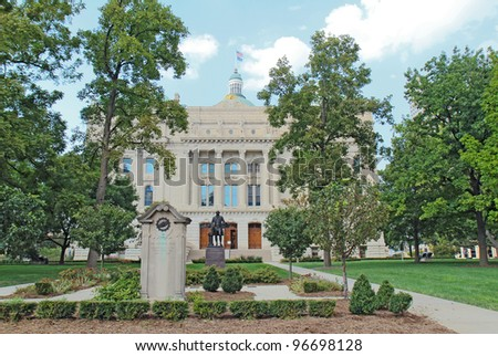 View of the south entrance to the Indiana State Capitol building in downtown Indianapolis showing monuments to the National Road and George Washington