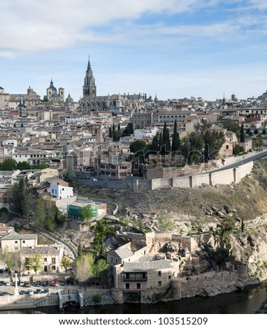View of the Spanish city of Toledo in vertical, seen from the river to the Gothic cathedral of Santa Maria, surronded by houses
