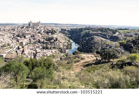 View of the Spanish city of Toledo, seen from the alcazar, in a structure of medieval city  In one side the tagus river