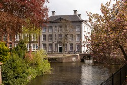 View of the stately canal house called Huis Cohen, in the old center of the historic city of Amersfoort.