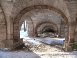 View of the stone arched vaults under the ramp of the Catherine Palace on a sunny winter day