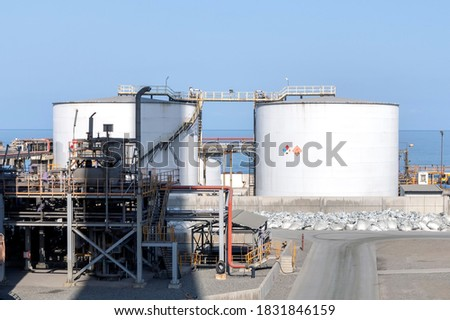 View of the sulfuric acid storage tanks in the chemical plant. Sulfuric acid or sulphuric acid, also known as oil of vitriol, is a mineral acid composed of the elements sulfur.