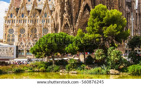Shutterstock View of the temple from the trees and water. Sagrada Familia cathedral by Antoni Gaudi, Barcelona, Spain Europe