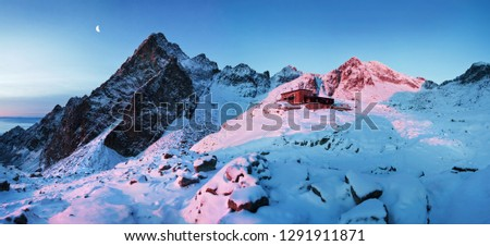 View of the Teryho Cottage (Teryho chata, Schronisko Teryego) at sunrise with pink colored mountain peaks and Small Cold Valley, Vysoke Tatry (High Tatras mountains), Stary Smokovec, Slovakia  Stockfoto ©