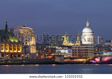 View of the Thames and St Paul's Cathedral at dusk. Lighting of buildings already on, but the sky was still bright. The most beautiful moment. London. UK