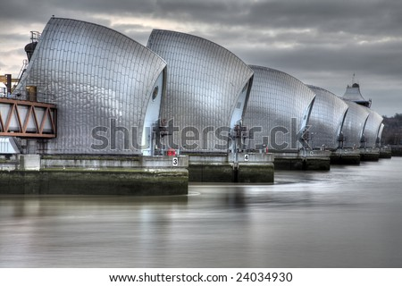 View of the Thames Barrier, showing six of the nine concrete piers. Thames Barrier is the world's second largest movable flood barrier, located downstream of central London in the area of Silvertown.