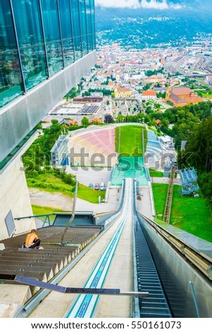 View of the track on a ski jump stadium overlooking Innsbruck town in Austria.