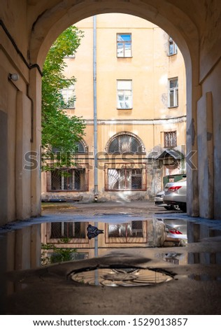 View of the typical yard and houses through the arch of the entrance in Saint-Petersburg, Russia
