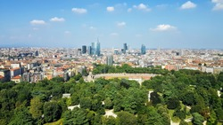 View of the vast Milan skyline on a clear Summer's day combining modern and old architecture, taken from the Tower Branca radio tower, Italy, Summer 2019