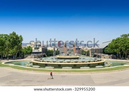 View of the Venetian Tower on Espanya square, Tibidabo on background. Barcelona. Spain. #329955200