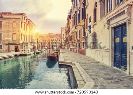 View of The Venice Street And Canal with boats in Venice At Sunny Day, Italy.