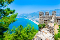View of the wall of the castle of Alanya and the sea, Turkey.  Alanya castle is a medieval fortress in the city of Alanya in southern Turkey