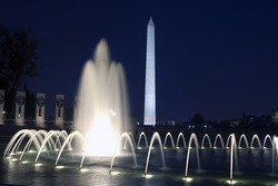 View of the Washington monument fronm the WWII memorial at night