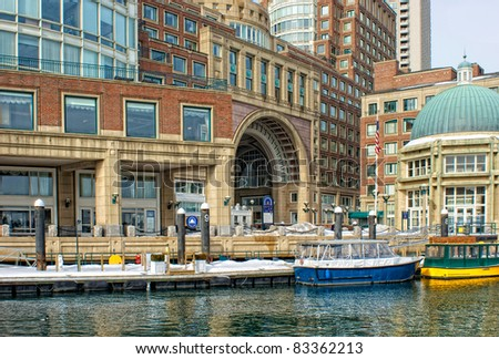 View of the water taxis and arched entrance to  Historic Rowe's Wharf from inside the wharf in the south end of Boston Massachusetts in winter.