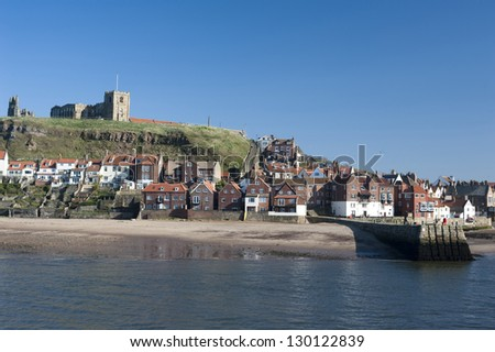 View of the waterfront and houses in Whitby in North Yorkshire with Tate hill in the background