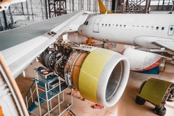 View of the wing and engine of the aircraft repair in the hangar