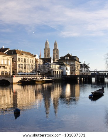 View of the Zurich historical city center reflecting into the river Limmat