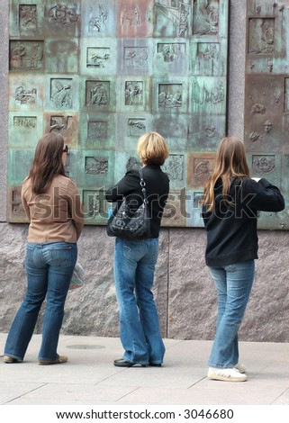 View of three female art aficionados at a part of the exhibit of the FDR memorial in Washington DC