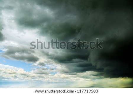 View of thunderstorm clouds above the sea