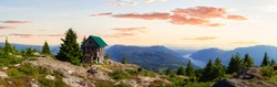 View of Tin Hat Cabin on top of a mountain. Dramatic Colorful SunsetLocated near Powell River, Sunshine Coast, British Columbia, Canada.