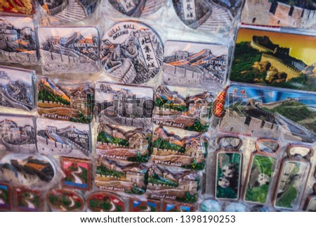 View of traditional tourist souvenirs and gifts from Beijing, China, with fridge magnets with text
