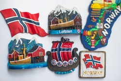 View of traditional tourist souvenirs and gifts from Lofoten Islands, Nordland, Norway, fridge magnets with text