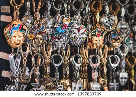 View of traditional tourist souvenirs and gifts from Venice, Italy and with toys, masquerade venetian masks, fridge magnets with text