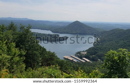 View of tranquil blue lake from lush green overlook