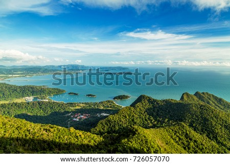 View of tropical island Langkawi in Malaysia, covered with tropical forests. Aerial view on the bay, marina and archipelago of smaller islands in Andaman sea. #726057070
