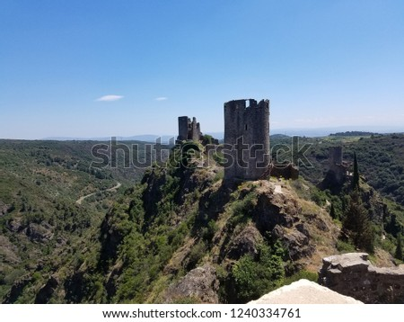 View of two of the four Cathar castles of Lastours on a mountainside in the French countryside with clear skies in the foothills of the Black mountains