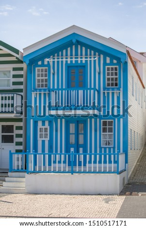 View of typical Costa Nova beach house, colorful striped wooden beach houses