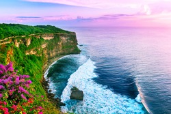 View of Uluwatu cliff with pavilion and blue sea in Bali, Indonesia