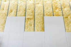 View of unfinished thermal partition dry wall with mineral wool.