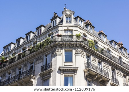 View of Unique traditional French windows and balconies. Paris, France. - stock photo