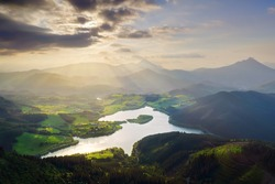 view of Urkulu reservoir in Basque Country with sun rays