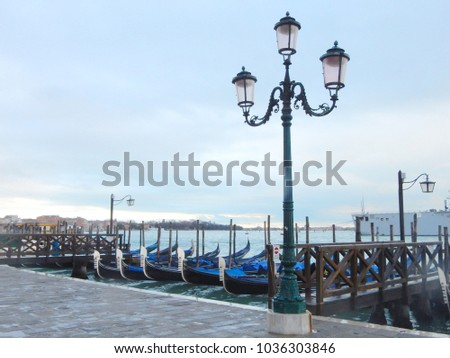 view of Venice with gondolas and street lamps #1036303846