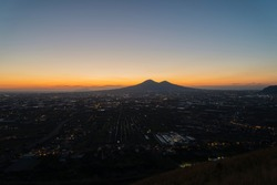 View of Vesuvius illuminated by the colors of the sunset