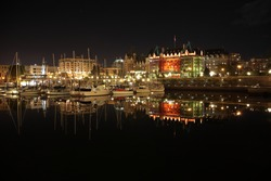 View of Victoria Harbor with sailing boats and yachts during night in Vancouver island, BC, Canada