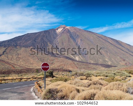view of volcano Teide, Tenerife, Spain, with stop sign in foreground