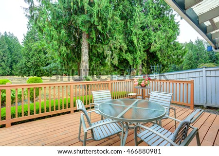 View of walkout deck with Patio furniture. House exterior in Tacoma. Northwest, USA #466880981
