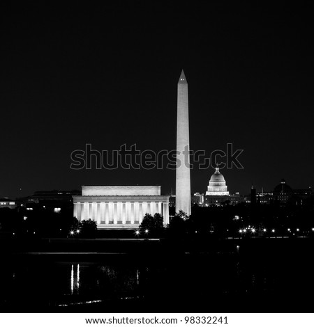 View of Washington DC skyline at night with lit up Lincoln Memorial, Washington Monument and the Capitol