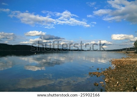View of water and sky from beach with oysters