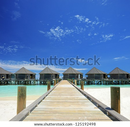 View of water villas resort on a Maldives island, shot with a tilt and shift lens