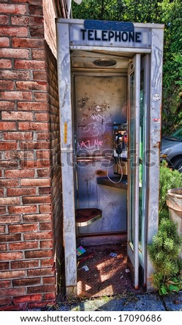 View of well used telephone booth, unoccupied. - stock photo