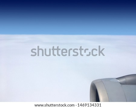 View of white havenly ocean from stratosphere from flying airplane with engine in right down corner #1469134331