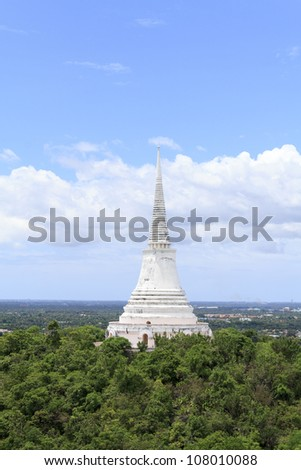 View of white pagoda on the hill top in Petchburi, Thailand
