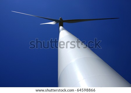 view of white  pylon and rotary of wind mill power plant