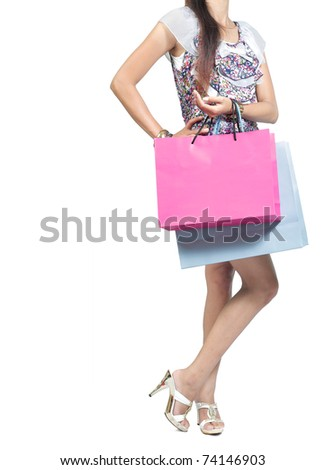 view of woman carrying shopping bag. isolated over white background