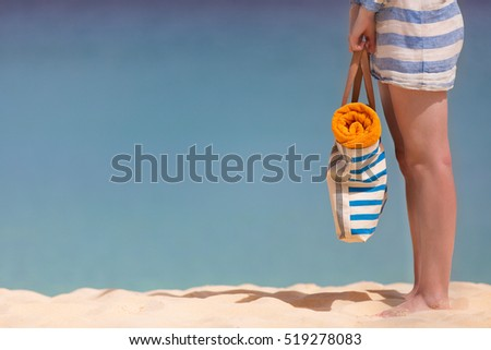 view of woman's legs at perfect caribbean beach, vacation concept with copyspace #519278083
