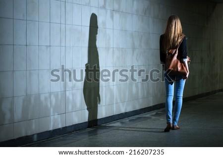 View of woman walking alone at night